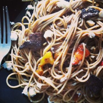 close up eating pasta